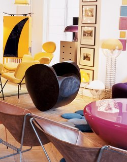 Like a Kid in a Candy Store - Photo 12 of 14 - Krzentowski claims a rare pair of 1952 Paulin chairs for Muebles T.V. are the origin for the design of his famous Ribbon chair. Ron Arad's Rolling Volume makes for dubious seating.