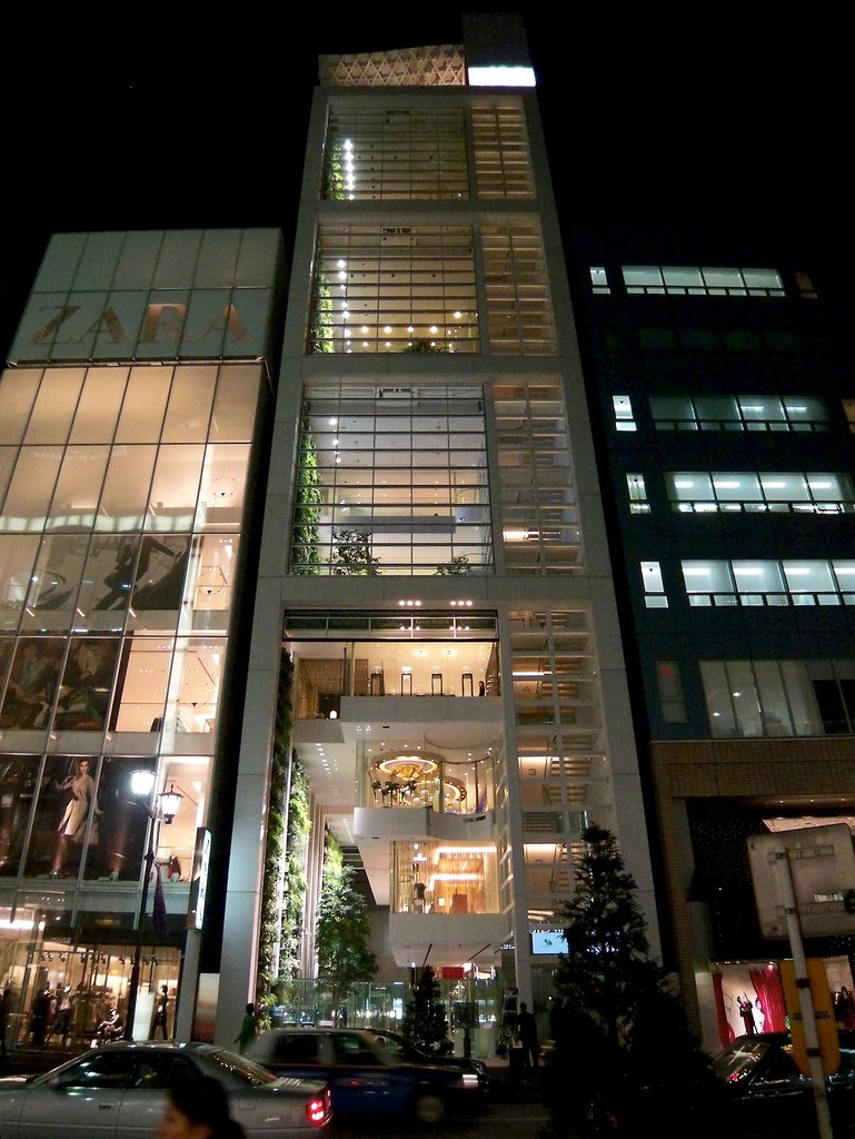 Nicolas G. Hayek Center (Tokyo, Japan: 2008)  How do you create retail frontage for seven different Swatch group brands when the building you're working with is only 56-feet wide? Shigeru Ban solved this challenge by stacking stores on top of each other in this Tokyo boutique, and then creating a small series of ground floor showrooms with individual elevators only linking to the specific brand. It's a structure that works like clockwork, a fitting design for the boutique watchmaker.
