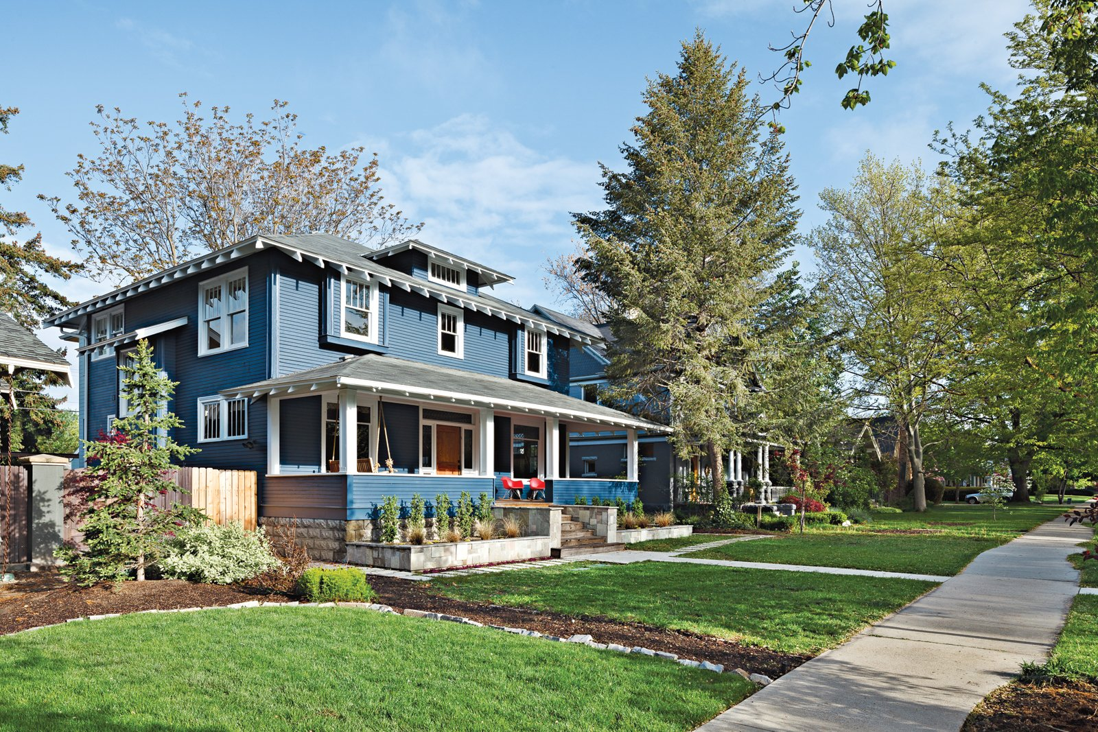 The front of the 1910 house belies the modern extension architects Doug   Skidmore and Heidi Beebe created to   extend the family's living space.  Photo 5 of 11 in An Airy Addition to a Historic Boise Home
