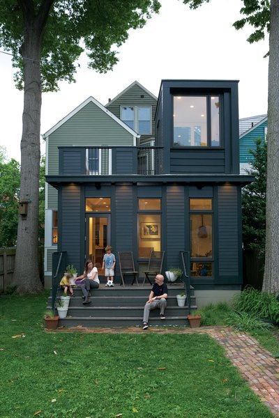 Juliet Gray, Mathias Kolehmainen, and their sons Cooper and Cyrus have a new favorite hangout: the wide back steps on the addition, which double as theater seating. (They project movies from the second-floor balcony onto an out-building across the yard.)