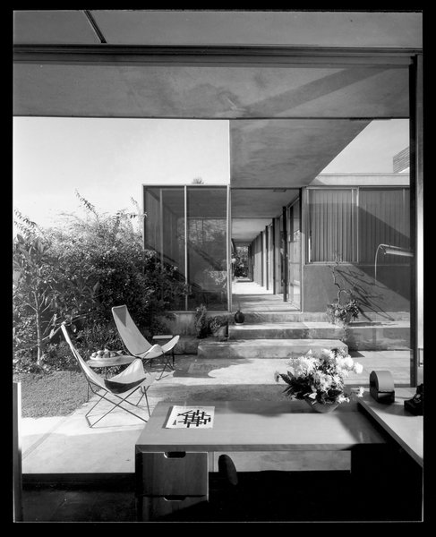 """Built between 1947 and 1950, the Shulman house was the result of a collaboration between the photographer and architect Raphael Soriano, and served as Shulman's home for more than half his life. Perched on a hill in Laurel Canyon on Woodrow Wilson Drive, the house was designated a Los Angeles Cultural Heritage monument in 1987. The one-story, exposed-steel-frame structure is defined by its central """"spine"""" and surrounded by gardens that Shulman left in a somewhat wild state."""
