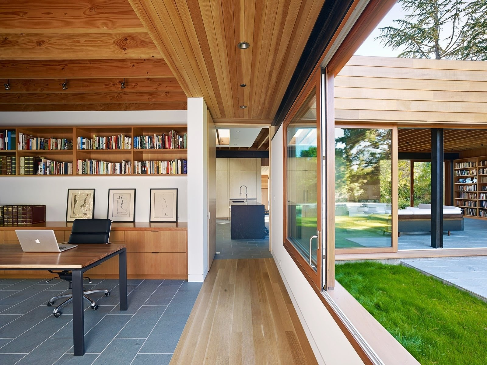 The relationship between interior and exterior becomes crucial in the articulation of the residence. Tagged: Office, Chair, Slate Floor, Bookcase, Study, and Desk. A Sustainable Home in Silicon Valley - Photo 5 of 8