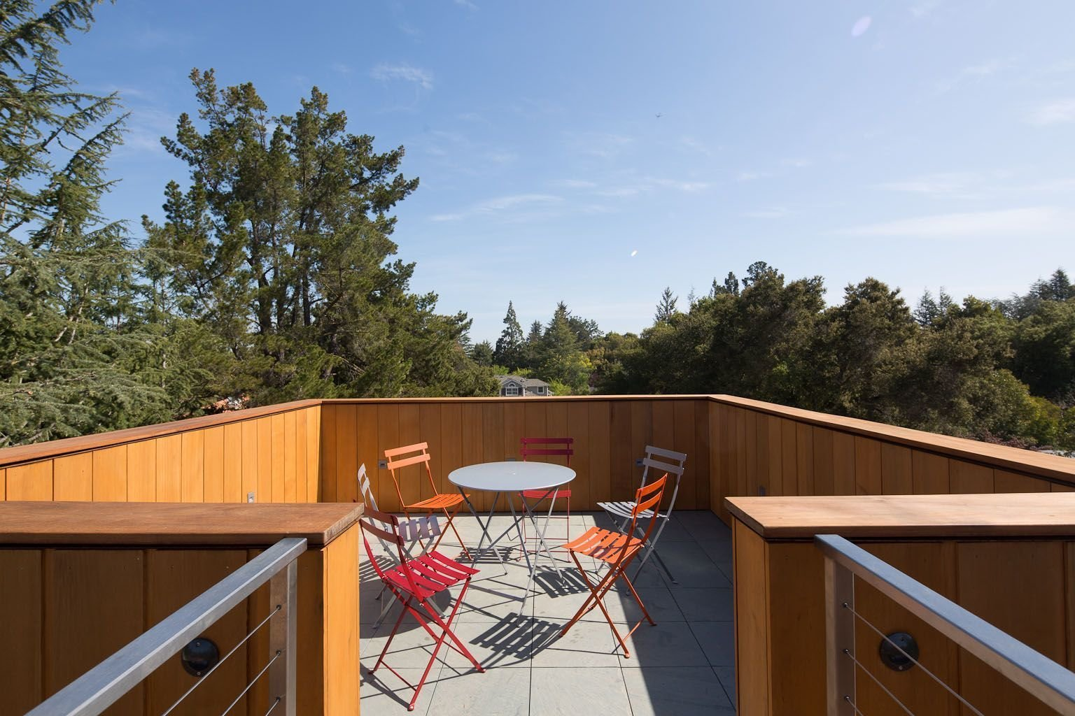 Atop the 30-foot tower, a roof deck emerges through the trees, providing a unique vantage point of the structure below and the surrounding townscape. Tagged: Outdoor and Rooftop.  Photo 8 of 8 in A Sustainable Home in Silicon Valley