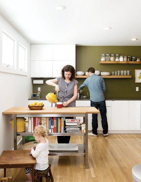 In the kitchen, artist Riley McFerrin installed custom floating shelves.