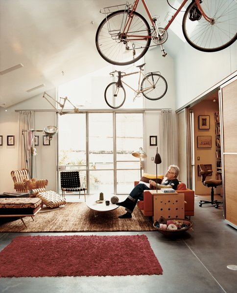The living room is a comfortable melange of pieces Baker grew up with, such as the Robsjohn-Gibbings chaise, and ones he's added, such as the Frank Gehry Power Play club chair.