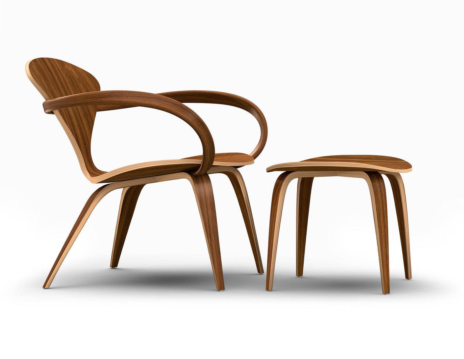 The side view of the Cherner Lounge Arm Chair and Ottoman showcases the sinuous curvature of the molded plywood. This design recalls the look of the original chair designed by Norman Cherner in 1958.