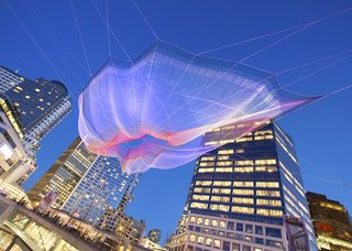 "Janet Echelman's ""Skies Painted with Unnumbered Sparks""<br><br>Created to celebrate the 30th anniversary of the TED Conference and only up from March 15-22, the web of netting suspended between the Fairmont Waterfront and the Vancouver Convention Center was a wonder. Echelman says her work is, in part inspired by the idea of ""feeling sheltered, but connected to the limitless sky,"" and the crowds that gathered and interacted seemed to feel similarly inspired.<br><br>Credit: Ema Peter"