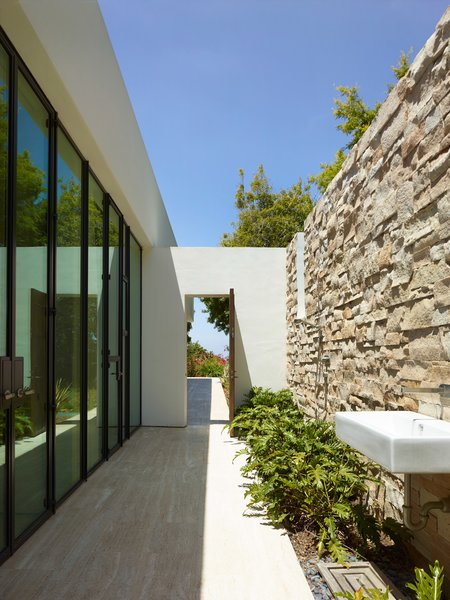 An outdoor sink ties indoor living spaces into outdoor living spaces, adding to the fluidity and openness of the home.