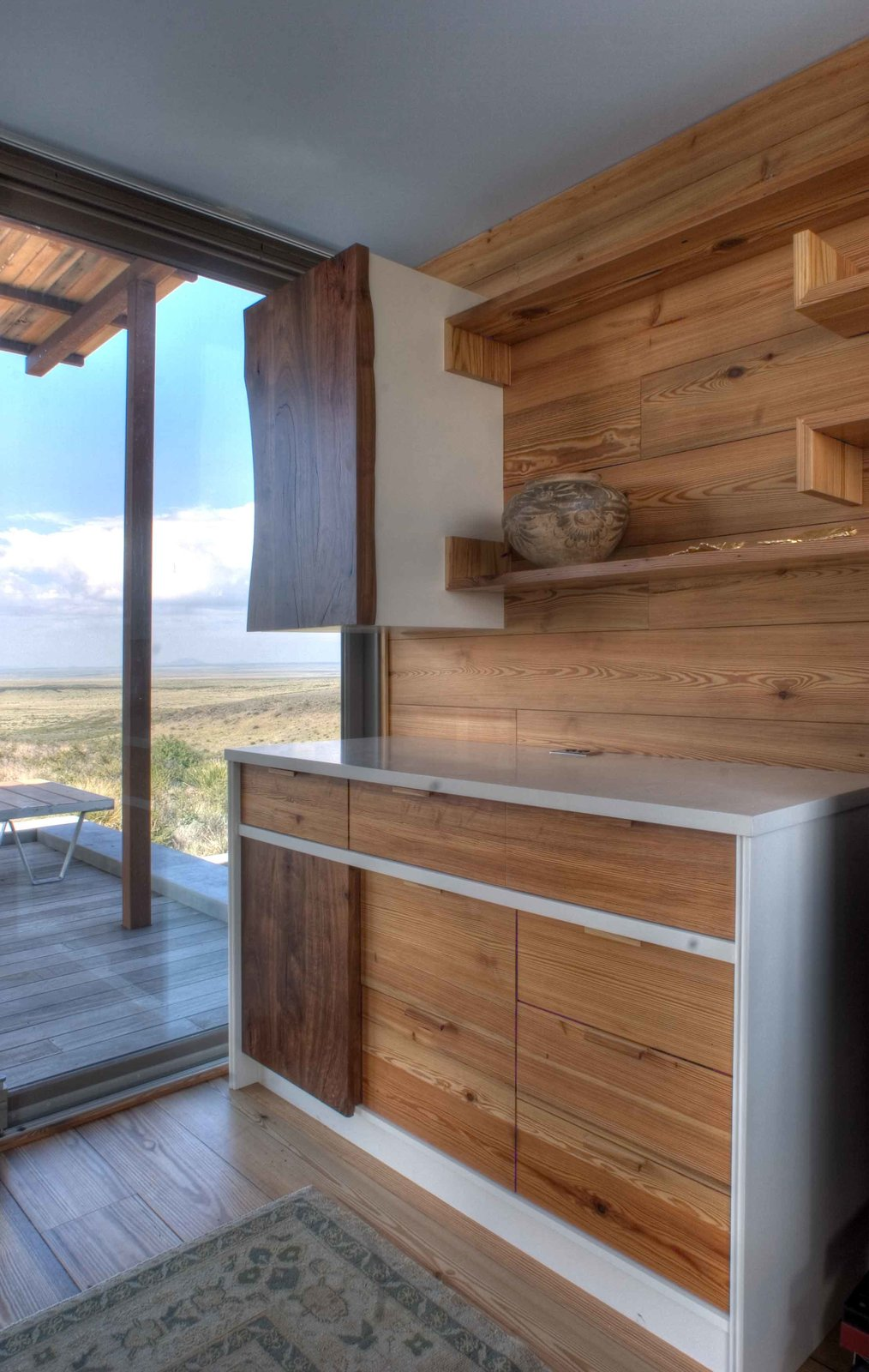 The kitchen cabinets are custom-made from salvaged cypress. Tagged: Storage Room, Shelves Storage Type, and Cabinet Storage Type.  Kitchens with Killer Views by Andrea Smith