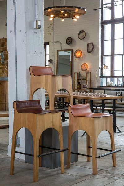 One of our favorite finds at the showroom, custom leather and wood barstools.