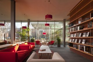 The Living Room, with vibrant red couches selected by the architect. Not pictured: Renzo Piano.