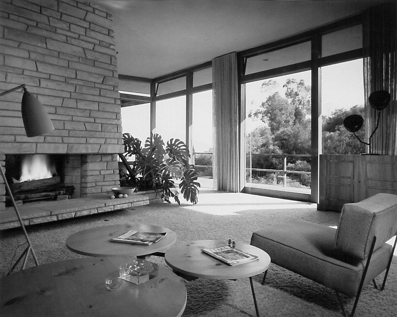 Gretta Grossman's work in the interior of the Backus house in Los Angeles in 1950, the Grasshopper lamp prominent in the foreground. Plants played an integral part in Grossman's designs, often serving as room dividers in the open plans of her interiors. Photograph by Donald J. Higgins.  Photo 1 of 8 in Design Icon: Greta Grossman
