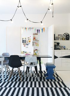 20 Modern Home Eat-in Kitchens - Photo 3 of 20 - Homeowner Susanna prefers a motley set of dining chairs over a coordinated set; that way, guests can pick their favorite when they sit.