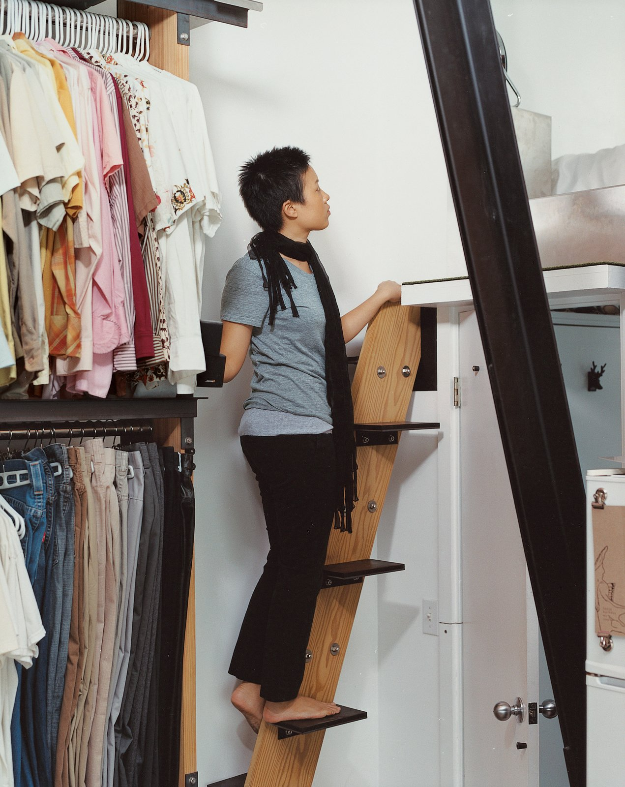 """The stairway to the sleeping loft is a riff on a ship's ladder: """"We spent a lot of time figuring out how much space we need to maneuver,"""" says David. """"It allowed us to make it as small and perfect as we wanted to."""" Instead of a handrail, sail cleats are bolted to the walls as hand-holds.  190+ Best Modern Staircase Ideas by Dwell from Modern Mixed Use in San Diego"""