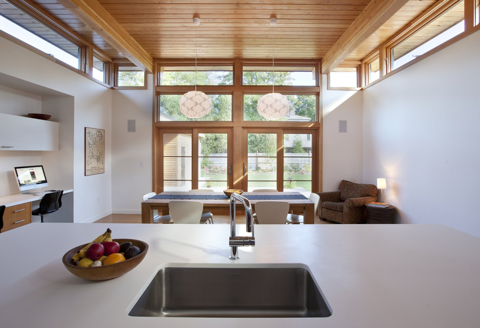 "The owners requested that the kitchen act as the center of the home so it was built at the rear of the property. ""It allowed us to pop off the roof and add clerestory windows to bring in an abundance of sunlight and fresh air,"" DiRocco said. The sink is by Blanco and the faucet is by Grohe. Tagged: Kitchen and Undermount Sink.  Shining Examples of Clerestory Windows by Luke Hopping from A Midcentury Modern Renovation Opens Interiors and Admits More Sunlight"