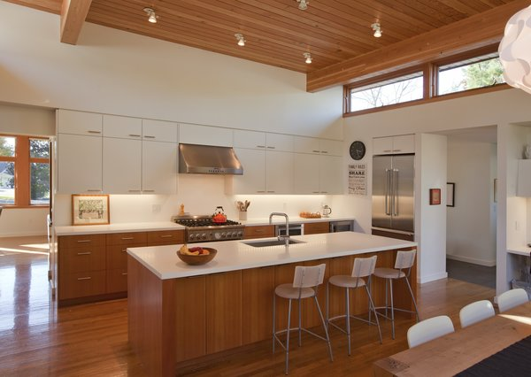 Ted Franklin custom cabinets and Artic white Formica countertops can be found in the kitchen. Thermador appliances—including a wine refrigerator—are spaced throughout the room.