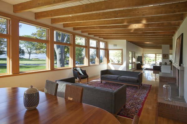 Fir laminate decking ceilings run perpendicular to exposed beams in the dining and living rooms.