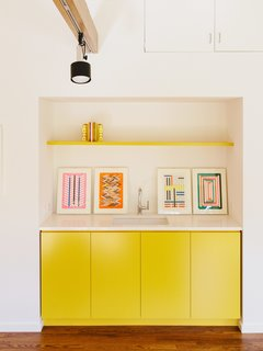 The Pantone Choice: Top 10 Colors for Spring 2017 - Photo 2 of 20 - In the office, existing track lighting illuminates cabinetry covered in Lemon Bar by Miller Paint.