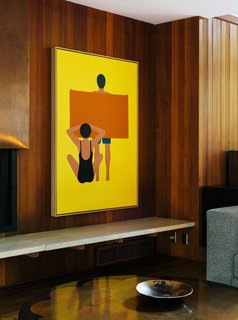 """Wood Paneling Loses its Dated Reputation with This Renovation of a 1959 Portland Gem - Photo 4 of 11 - In the living room, the painting is by Geoff McFetridge and the wood paneling is original to the house. """"Jewel-y color and simple shapes—they feel right in this house,"""" says interior designer Jessica Helgerson."""