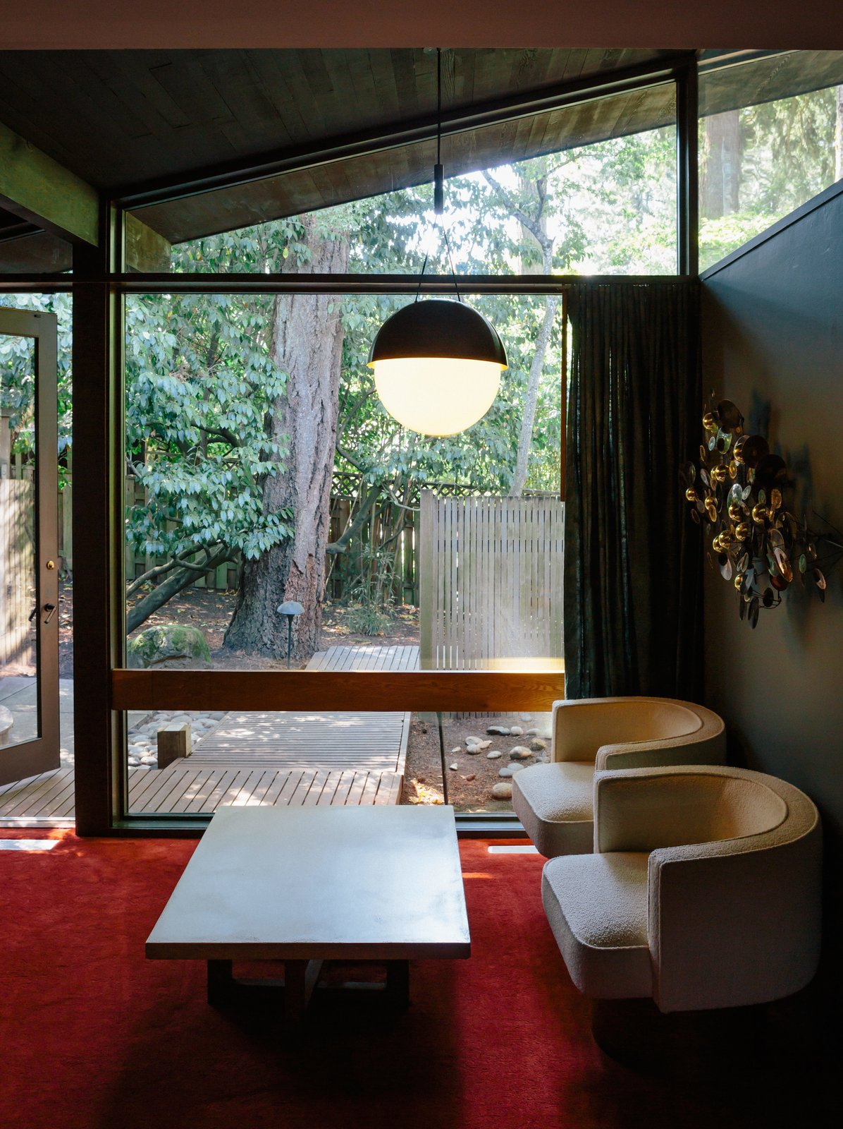 The couple designed the master bedroom, choosing a new red carpet inspired by the original and a Half Moon pendant by Allied Maker.  Photo 11 of 11 in Wood Paneling Loses its Dated Reputation with This Renovation of a 1959 Portland Gem