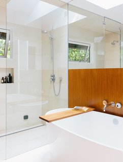 Wood Paneling Loses its Dated Reputation with This Renovation of a 1959 Portland Gem - Photo 6 of 11 - The master bath is a bright sanctuary with a freestanding tub by Victoria + Albert and Ecostat shower fixtures by Hansgrohe.