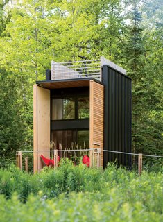 Take a Step Through 20 Huge Modern Doors - Photo 13 of 20 - Architect Bill Yudchitz asked his son, Daniel, to help him create a self-sustaining multi-level family cabin in Bayfield, Wisconsin.
