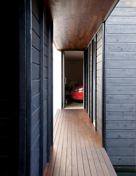 A perpendicular walkway leads right to the garage and laundry areas.