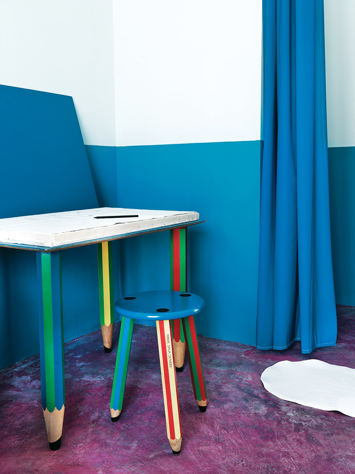 The pencil-themed desk and stool are by Pierre Sala.  Photo 12 of 12 in Matali Crasset Renovates Monory Farmhouse