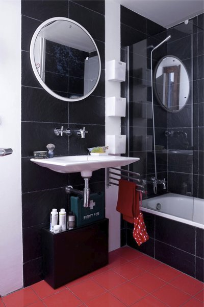 "In the bathroom, recycled plastic tiles surround the tub. Designed by Ramón Benedito for Roca, the Kalahari sink was fashioned from a single piece of ceramic. ""There's less waste than the standard sink,"" says Scholtus, who also installed low-flow aerators in the faucets and a Stop Flush water-conserving toilet.<br><br>Don't miss a word of Dwell! Download our  FREE app from iTunes, friend us on Facebook, or follow us on Twitter!"