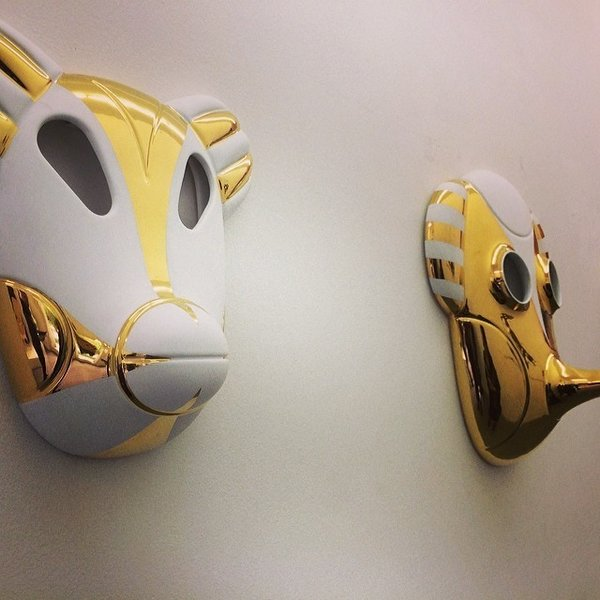 Masks by Jaime Hayon, glimpsed in Ventura Lambrate.
