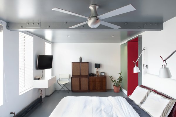 """Two-bedroom apartments are coveted in Manhattan, but the reality is that we are just two people, and the second bedroom had become neglected storage space,"" Fontanez says. Combining the two into one reaped big rewards. ""Now we wake up to a row of four windows and a variety of birds singing,"" Russell says."