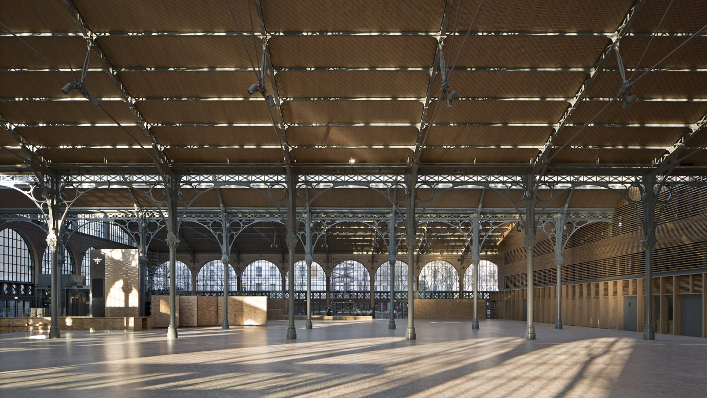 """View from the Nave of Carreau du Temple  """"Because it's one of the only remaining examples of this type of architecture, we have a responsibility to make the restoration ideal,"""" Milou says. """"We wanted to make it even lighter than it was, even more free, to truly open up the roof and the envelope.""""  Photo Credit: Fernando Javier Urquijo/studioMilou architecture."""