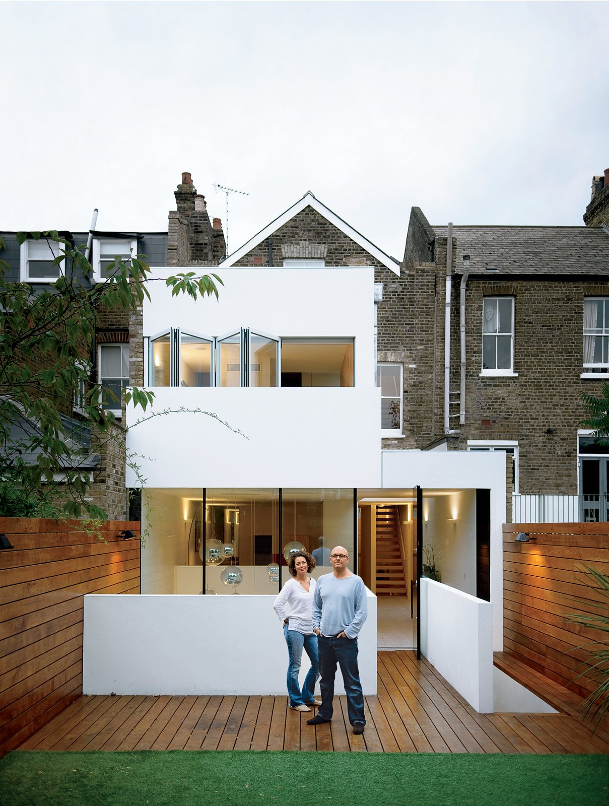 Bruce Thatcher and Kirsty Leighton behind their London home. Tagged: Outdoor, Small Patio, Porch, Deck, Back Yard, and Wood Patio, Porch, Deck.  Photo 1 of 10 in Composite Index