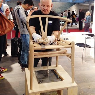 Milan Design Week: Day Three - Photo 1 of 8 - Carl Hansen & Søn show how the seat is woven on a Hans Wegner Wishbone chair.
