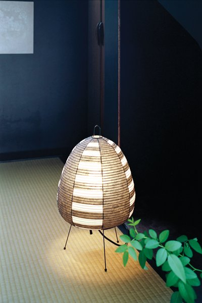 The teahouse is lit by Isamu Noguchi's classic mid-century Akari 1AS lamp.