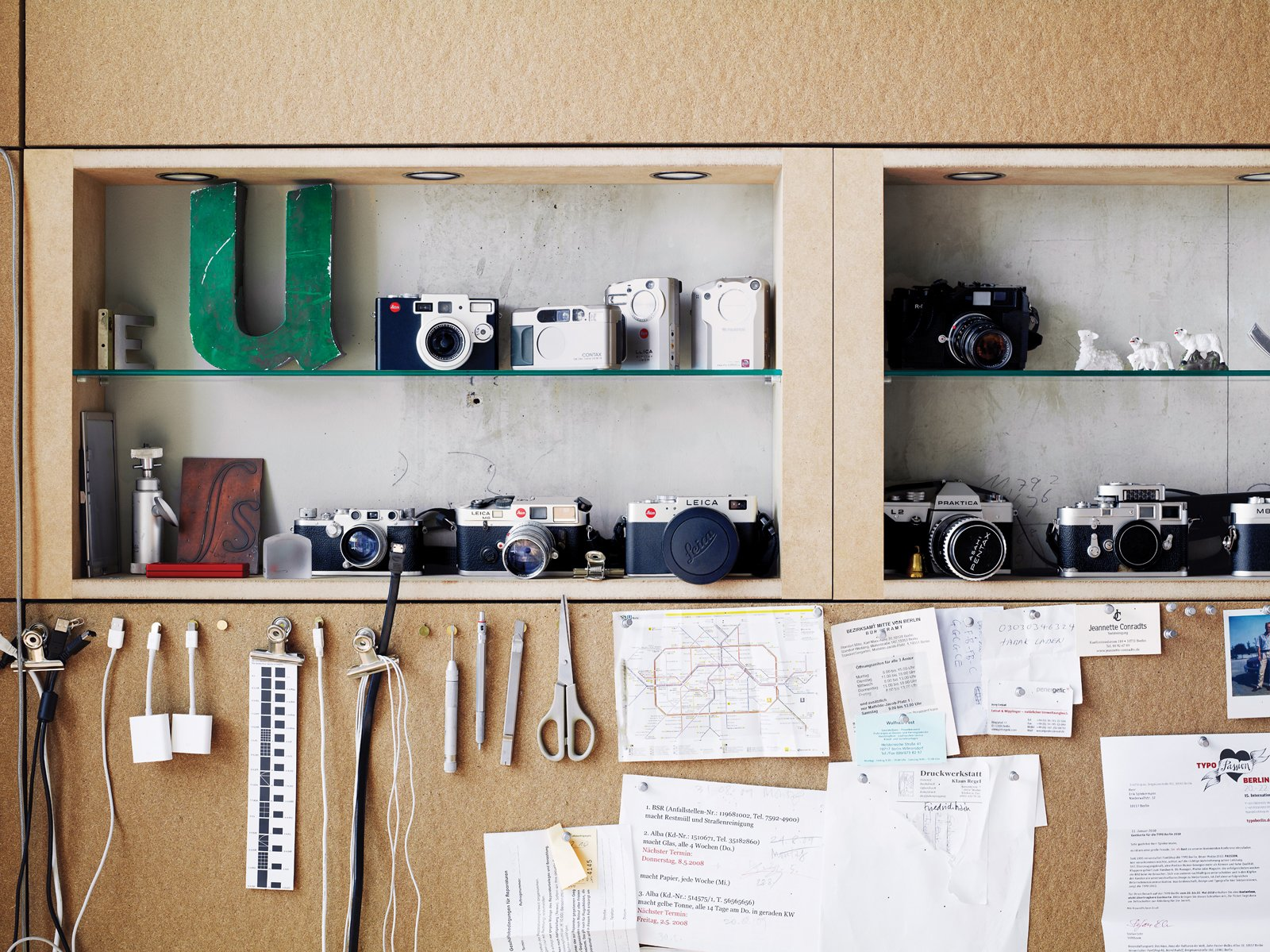 """The office houses the letter """"U"""" as well as cameras. Tagged: Office, Shelves, and Craft Room.  Photo 11 of 16 in A Rational Approach"""