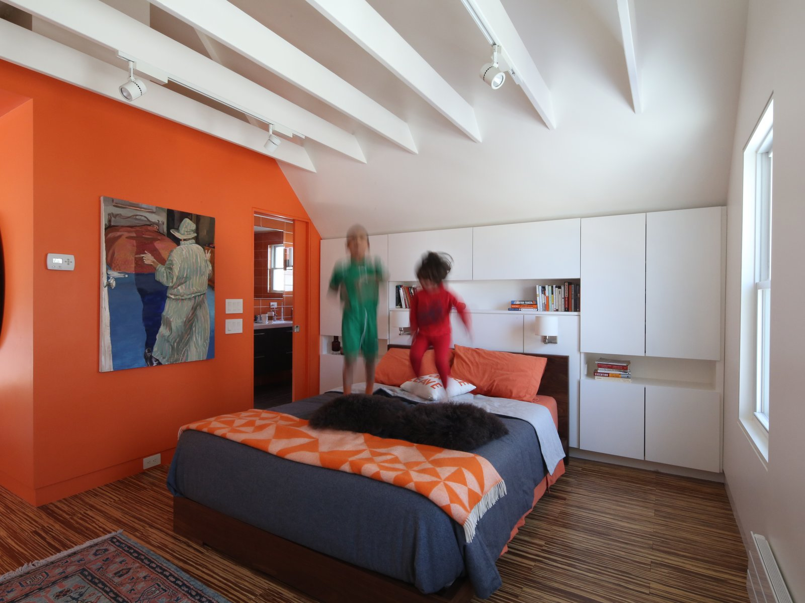 Residents Ethan and David gave architect Anne Barrett of 30E design one directive when renovating their attic space into a master suite: to make it feel like a refuge, their own private boutique hotel. Although an adult retreat was impossible after their children, Marly and Yandel, adopted it, the resulting colorful design is a true getaway. Photos courtesy 30E design  Bedroom by Dane Cupp from How To: Bright Bedroom Renovation