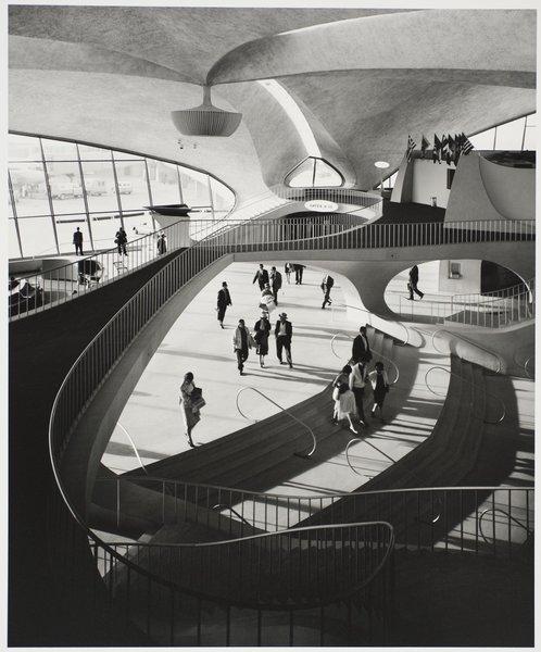 TWA Terminal, interior, designed by Eero Saarinen, 1962. Gelatin silver print. Carnegie Museum of Art, Purchase: gift of the Drue Heinz Trust. Image courtesy of the Carnegie Museum of Art, copyright Ezra Stoller/Esto, Yossi Milo Gallery.