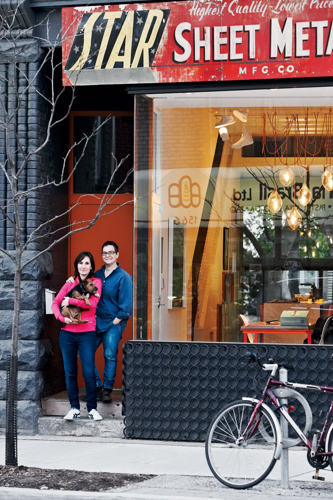 Architect Tamira Sawatzky and artist Elle Flanders get an awfully good view of their busy Toronto street from their office and dining room. Tagged: Exterior, House, and Glass Siding Material.  Photo 1 of 11 in Don't Let the Sign Fool You, This Old Storefront is a Home