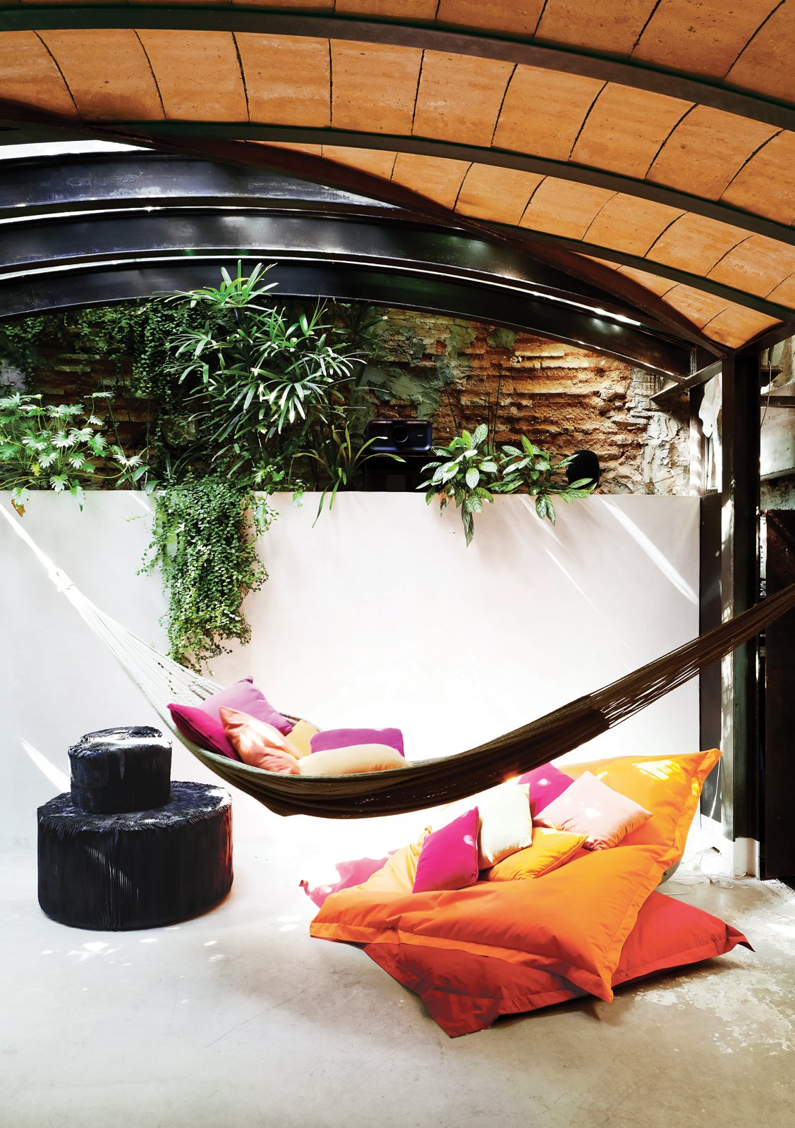 At one end of the space, which is topped by a barrel ceiling, a hammock offers a tantalizingly cozy place to nap.  Photo 14 of 23 in The Barcelona Home Like No Other