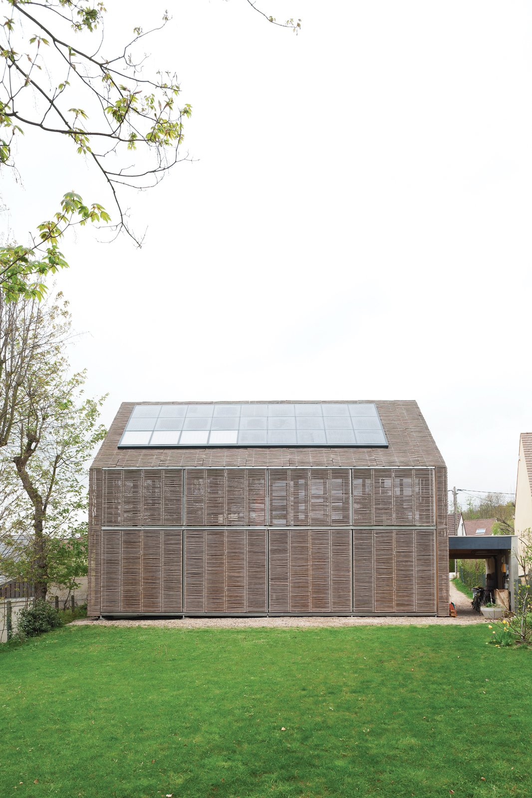 Passive ProgressiveStunning bamboo covers this house in Bessancourt, France, on all four sides, its lattice making up a striking set of adjustable screens that allow the residents to modify the facade to suit the weather. Photo by: Nicholas Calcott Passive Progressive - Photo 1 of 8