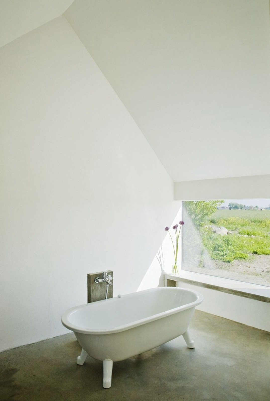 "The original washing house connected to the main house was in such bad shape that it had to be demolished. LASC ""reincarnated"" it as a spacious bathhouse, complete with a tub‐with-a-view and a heated concrete window bench. Photo by Laura Stamer.  Baths by Lara Deam from How to: Designing for Warm Weather"