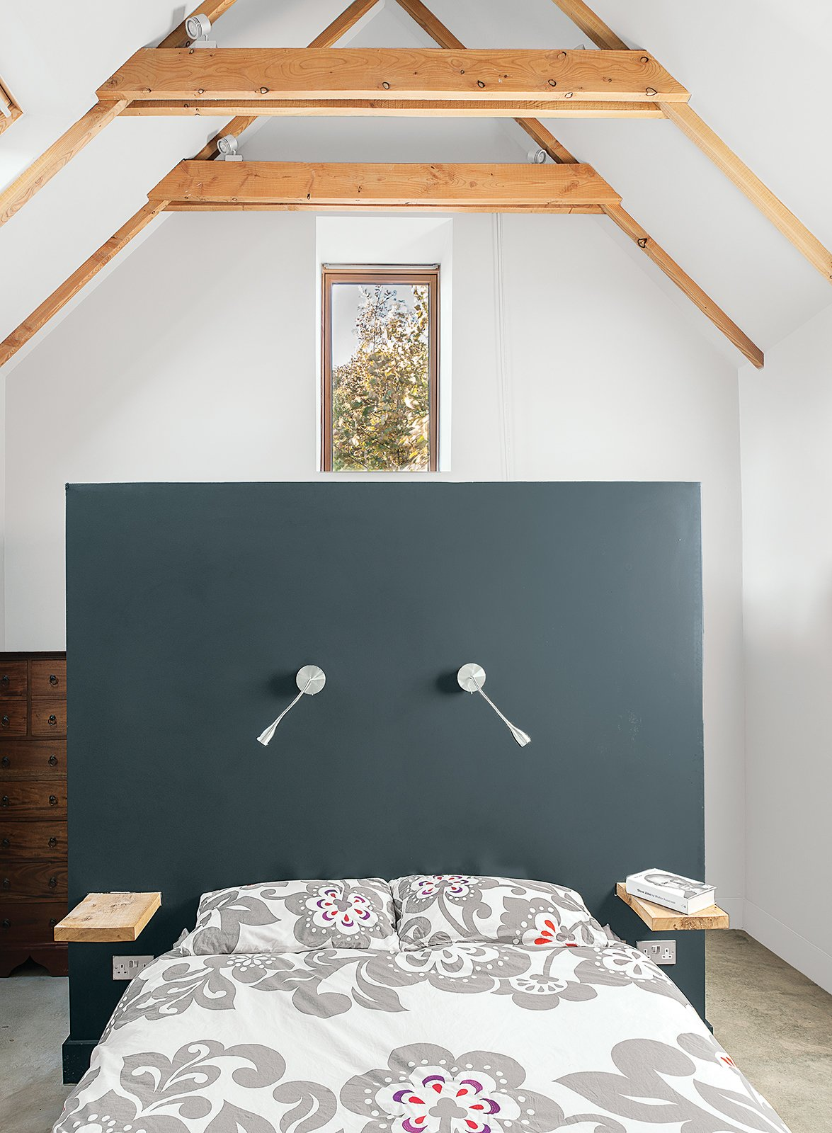 Designer Sue Macintosh chose the Farrow & Ball Off-Black paint for the master bedroom. Tagged: Bedroom, Bed, and Wall Lighting.  Bedrooms by Dwell from This Farmhouse is a Cor-Ten Steel-Clad Dream
