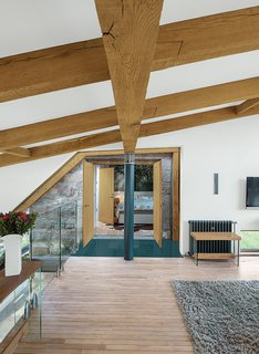 8 Beautiful Home Projects Using Reclaimed Wood - Photo 6 of 8 - Different types of reclaimed wood, each from different sources, steal the show in this residence in the Scottish countryside by Glasgow-based architect Andrew McAvoy of Assembly Architecture. Thick, deep oak beams were reclaimed and reused for structural elements, while the maple flooring was salvaged from an old school in the nearby rural village of Aberdeen. The reclaimed wood was a critical contributor to the goal of sustainability in the home.