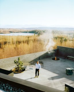 This Modern Cabin Is the Ideal HQ For a Family in Alaska - Photo 6 of 19 - The courtyard with its fire pit and infinity pond—extends the living area outdoors. The family has hosted events, weddings, and even a funeral here, and annual solstice parties are always a big hit with the neighbors.