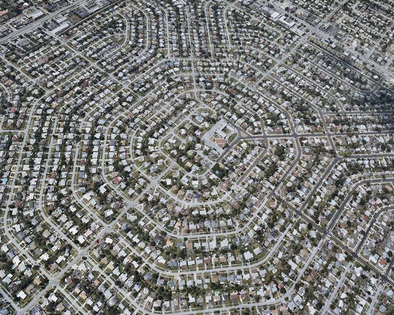 Streets and houses radiate outward from this hexagonal suburb in Florida. Gielen's perspective reveals the patterns formed by the streets (and yet invisible from street view). Photo by Christoph Gielen.
