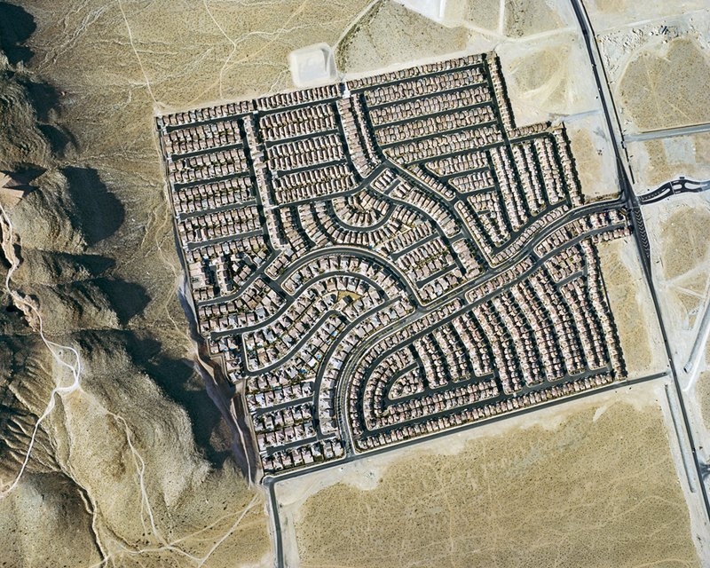 Nevada houses cluster inside a square frame. Photo by Christoph Gielen.