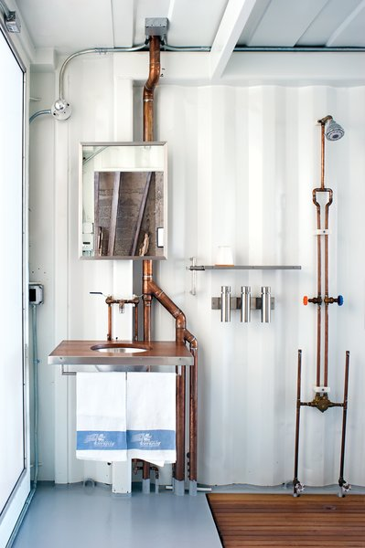 Exposed copper piping adds visual appeal to the guestroom.