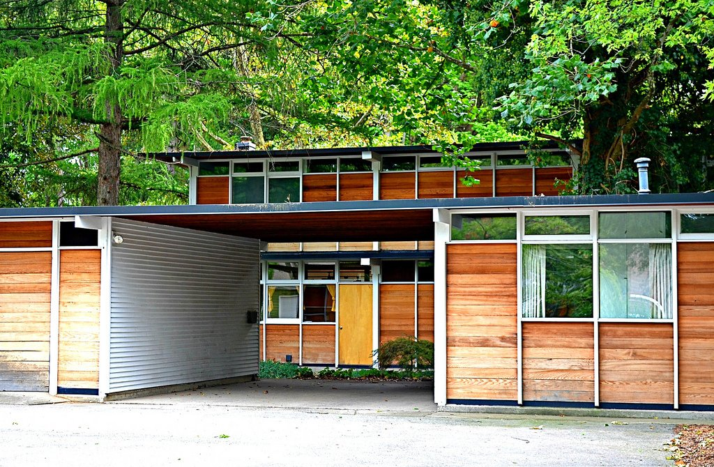 Max De Pree House  Designed in 1954, the Zeeland, Michigan home of Max De Pree—son of Herman Miller founder D.J. De Pree, and later the CEO—melded local style and history with Scandinavian cool, including a sleek vertical shape and a cedar exterior.  Photo credit: chicagogeek, via Creative Commons  Midcentury Homes by Dwell from 10 Things You Didn't Know About Charles and Ray Eames