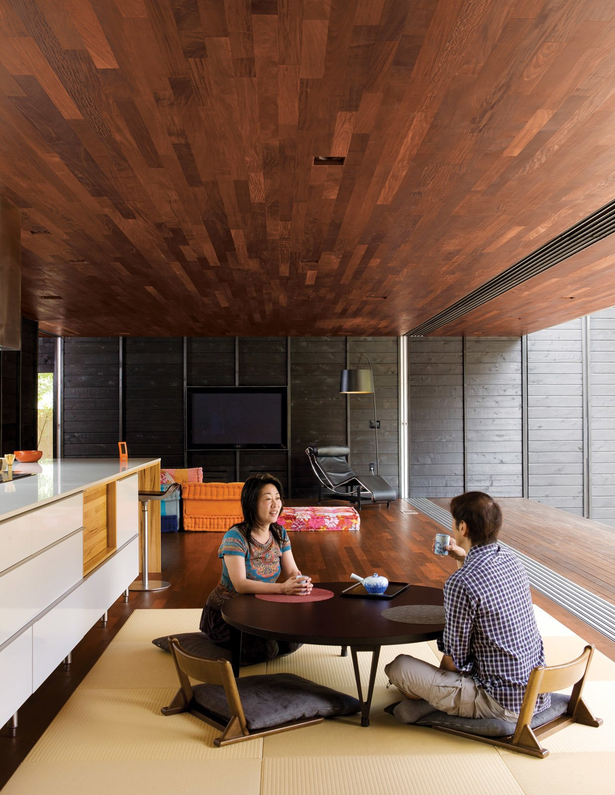 At the client's request the kitchen contains neither upper cabinets (Shino can't reach them) nor an oven (they only used the old one once—to reheat a pizza). A modular Roche Bobois Mah Jong sofa adds a decorative flourish to the living area while maintaining as low a profile as the traditional Japanese furniture.
